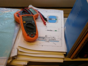 What I want to find from every lab: bunch of multimeters on a stack of documentation.